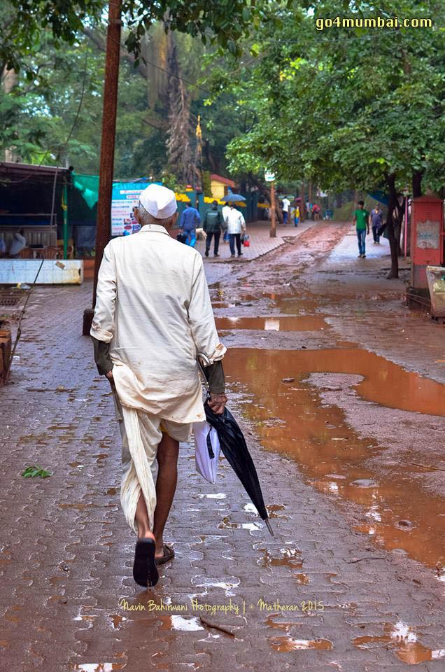 Matheran Everyday life, Man with Dhoti, Gandhi Cap & Umbrella
